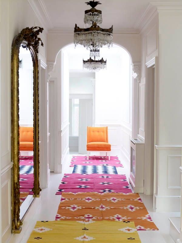 How To Layer Rugs For A Colourful Hallway